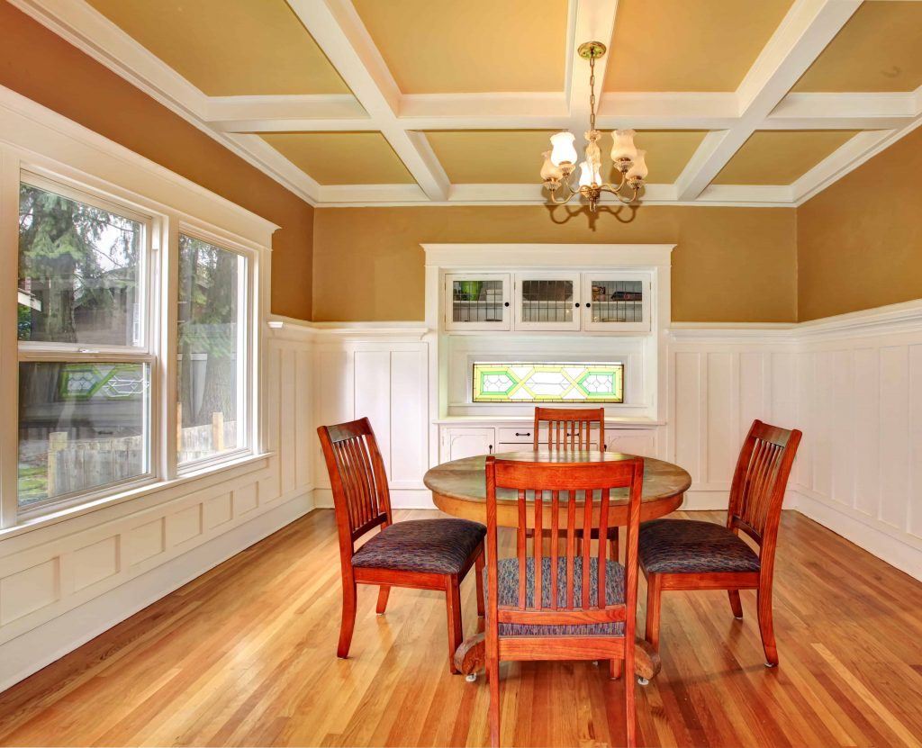 Dining room with coffered ceiling and custom built-in cabinet from FIX-IT of Macomb County