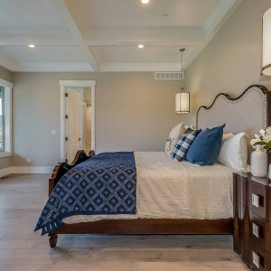 FIX-IT provides custom woodworking such as this bedroom's trim, coffered ceiling, and headboard