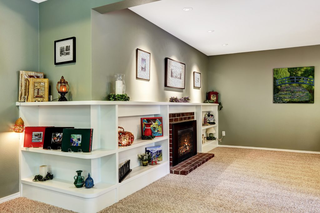 Built-in shelving unit in living room from Macomb County custom woodworking